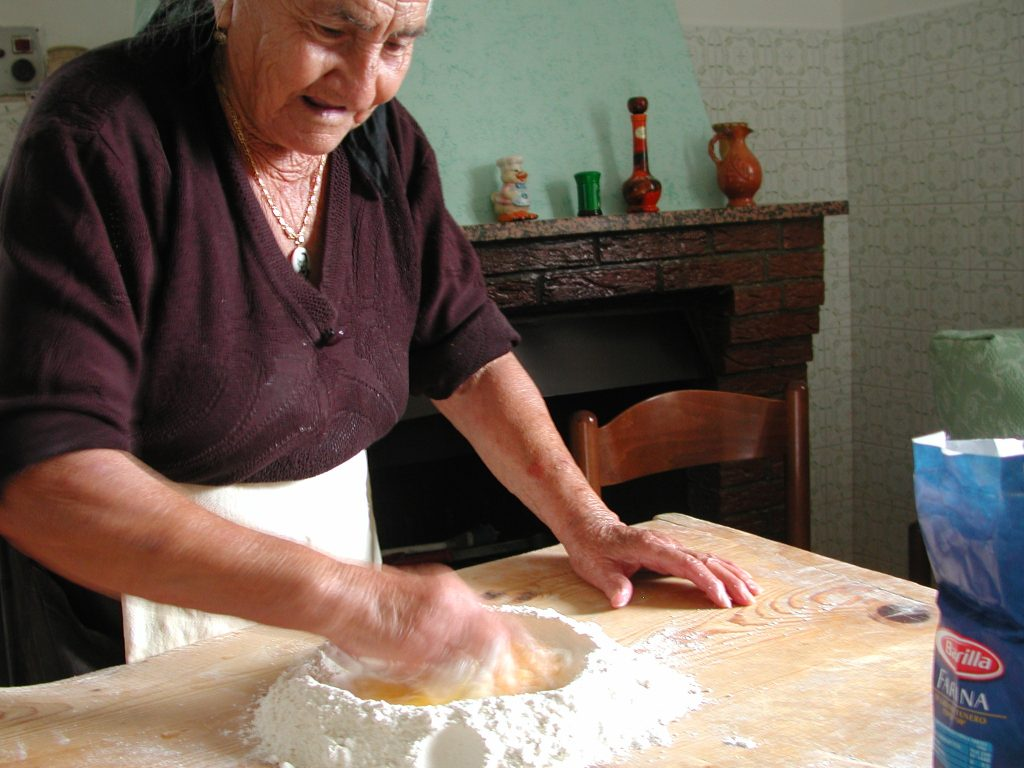 Nonna making fresh, homemade pasta.