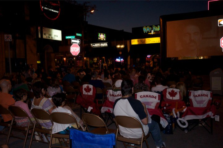 Families gather around the screen to watch The Princess Bride in the middle of downtown Windsor