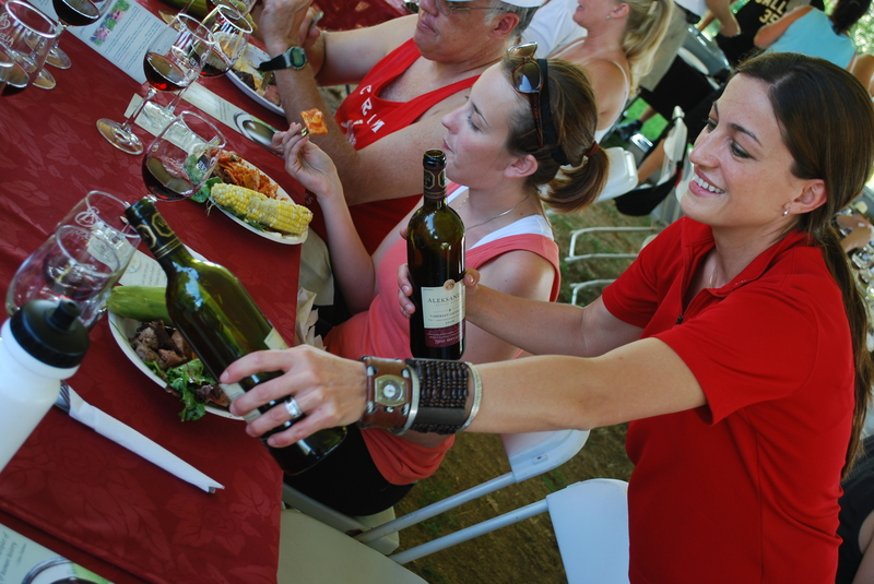 Izabela Muzzin of Aleksander Estate Winery pours some wine during the Wine Trail Ride meal.