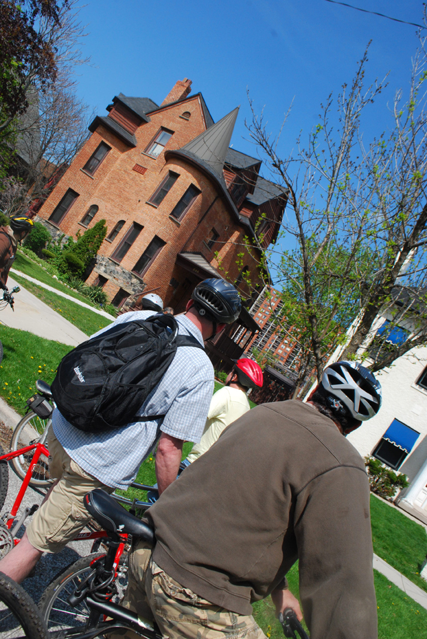 Bikes & Beers Cycling Tour participants look at some great architecture in Downtown Windsor.