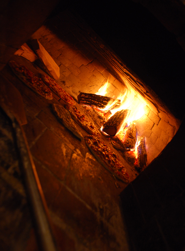 The pizzas in the wood fire oven at Centro Restaurant are almost ready for eating.
