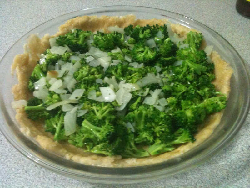 Pour the vegetable mixture into the crust .