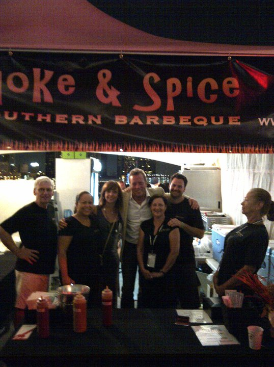 Celebrity chef David Adjey stops by the Smoke & Spice booth at Festival Epicure after eating at the restaurant earlier in the day