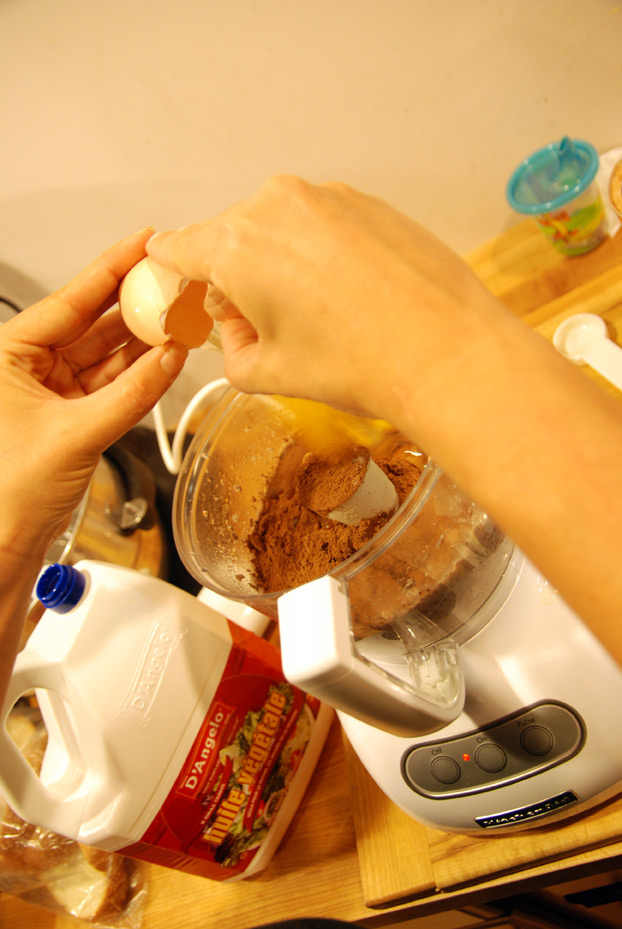 Add the eggs, oil, sugar, cocoa powder, vanilla extract,  baking powder, and salt and process until smooth.
