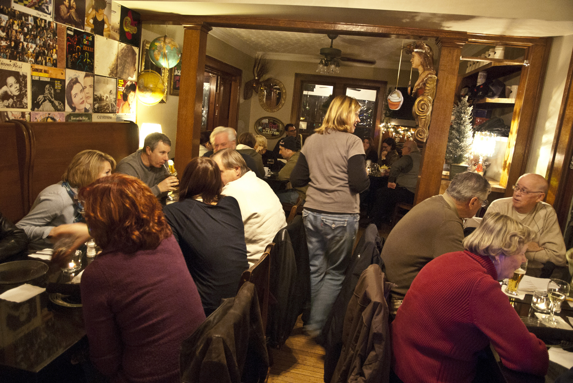 Participants discuss possible answers at Jack's trivia dinner nights, the first Monday of each month.