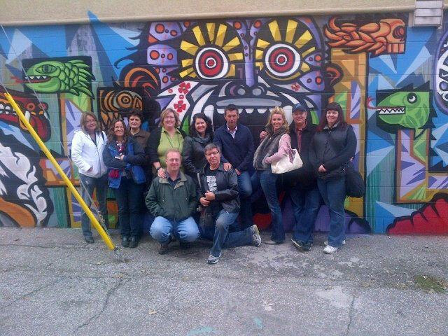 The Rye, Tequila and Beer, Oh My! Walking Tour posing in front of a Mexican mural