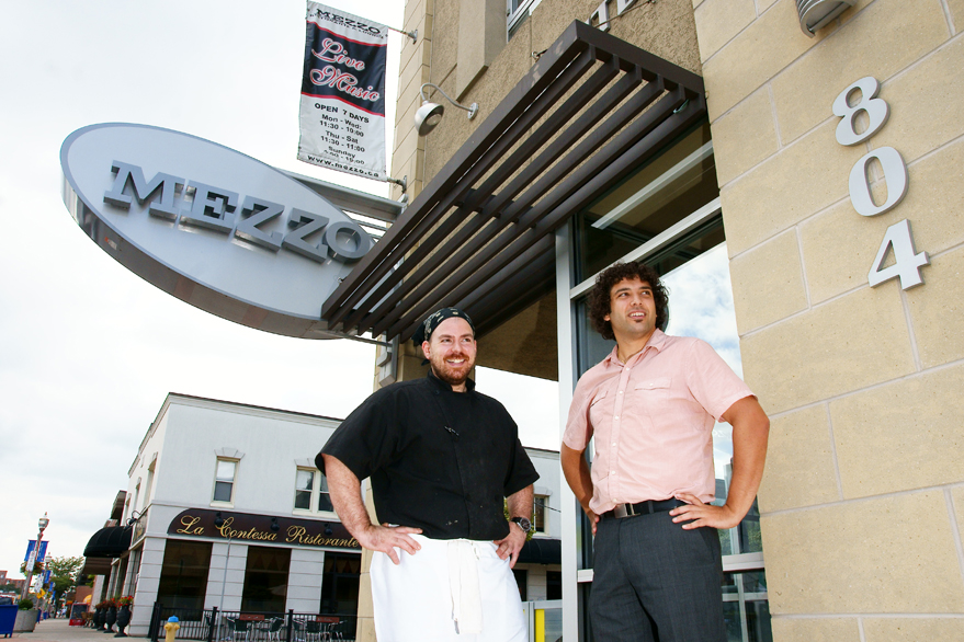 Michael Barlozzari of Mezzo Ristorante and Adriano Ciotoli of WindsorEats stand outside the Via Italia restaurant. Photo courtesy of Owen Wolter of Windsorite.ca