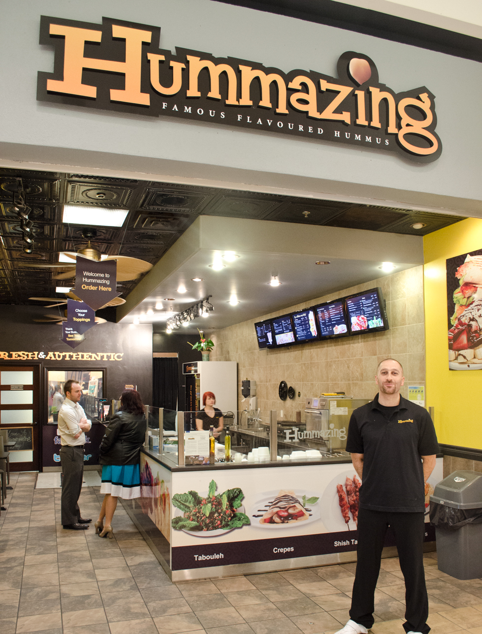 Fadi Dandachi stands in front of his business, Hummazing