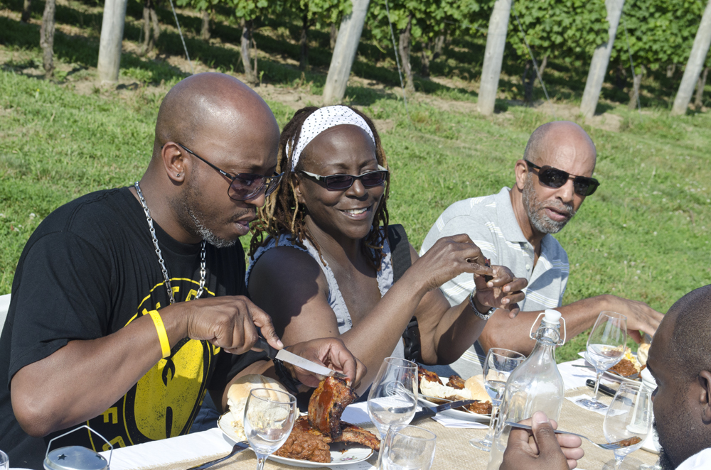 Participants enjoying the long table dinner on a Wine Trail Ride cycling tour