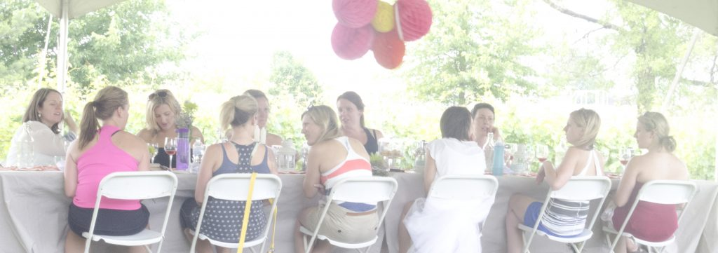 A bachelorette party enjoys our signature long table dinner during the Wine Trail Ride