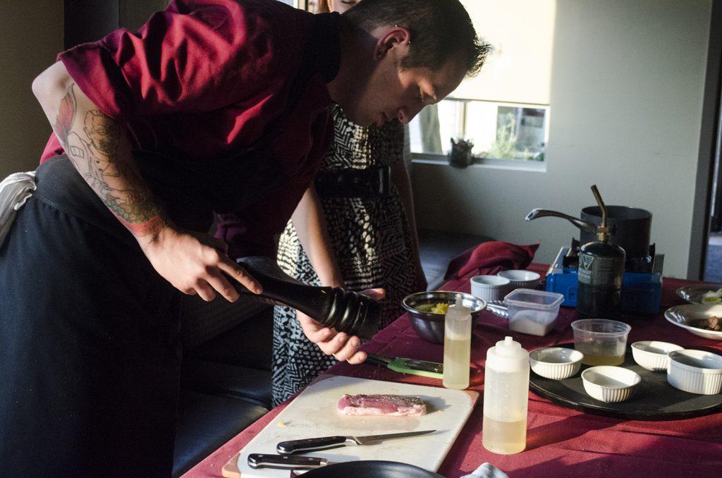 Chef Joshua Deneau prepares a dish during a cooking class at Mauro's on Erie