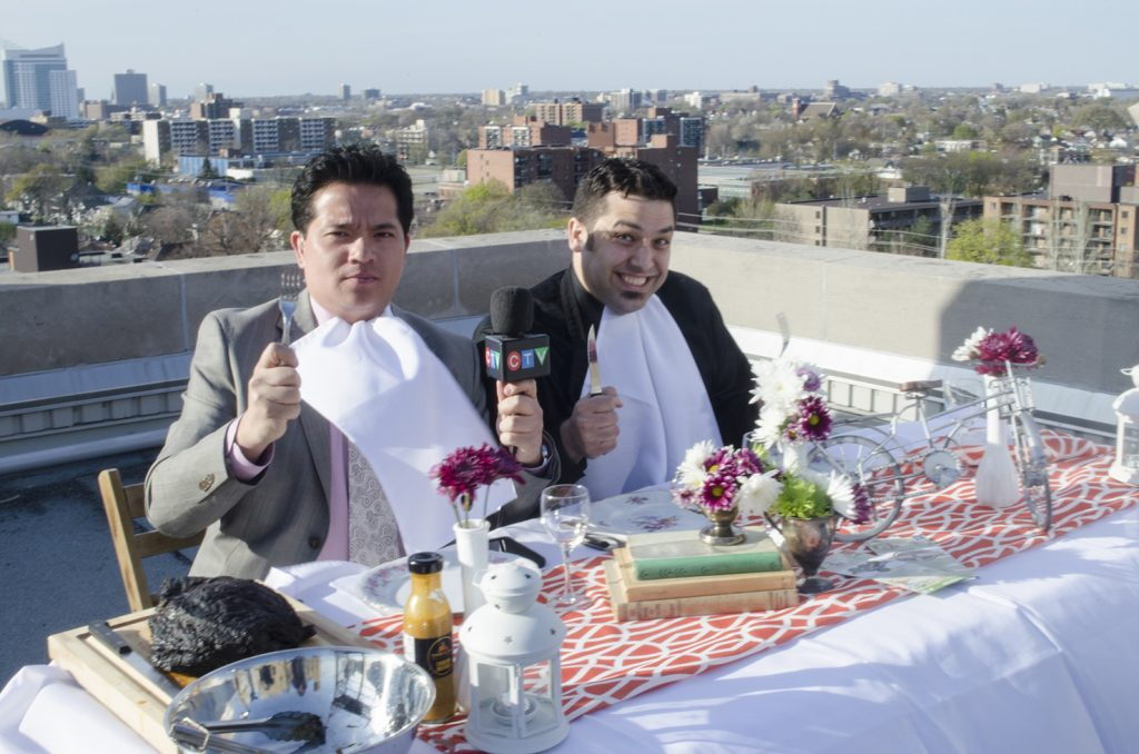 Arms Bumanlag and Adriano Ciotoli chowing down on the CTV Windsor rooftop
