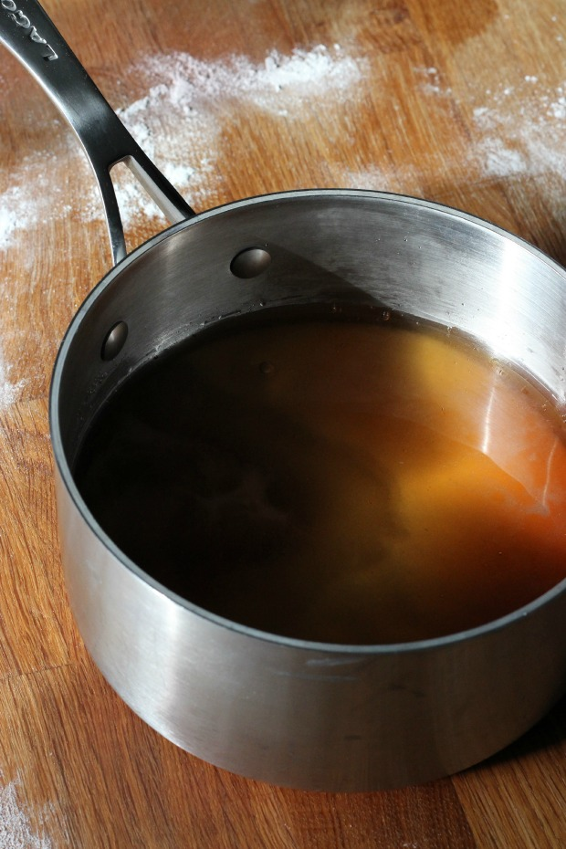 Bring corn syrup, water, salt to a boil.