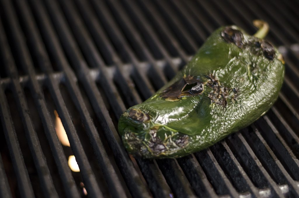 Grill and char the poblano pepper