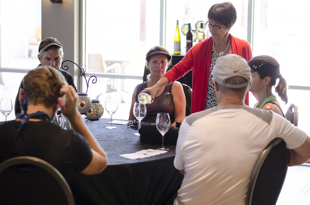 Guests of the Wine Trail Ride enjoy a tasting at Cooper's Hawk Vineyards