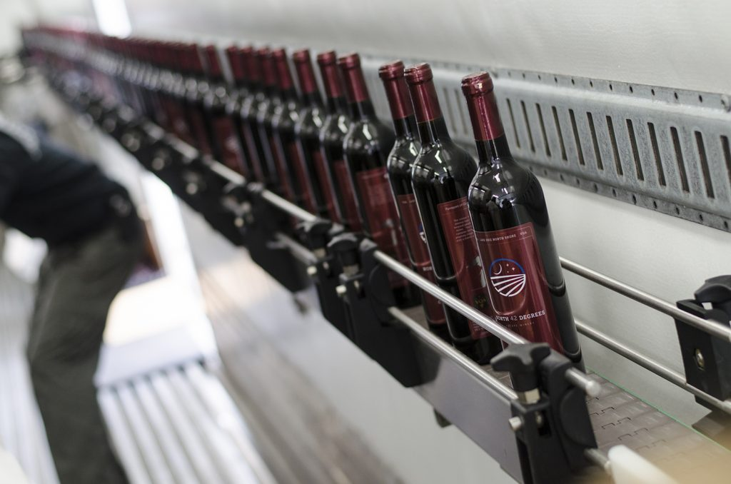 Bottles sliding down the line.