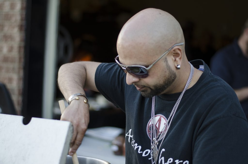 Nav doing what he loves to do. Cook and be cool in his shades.
