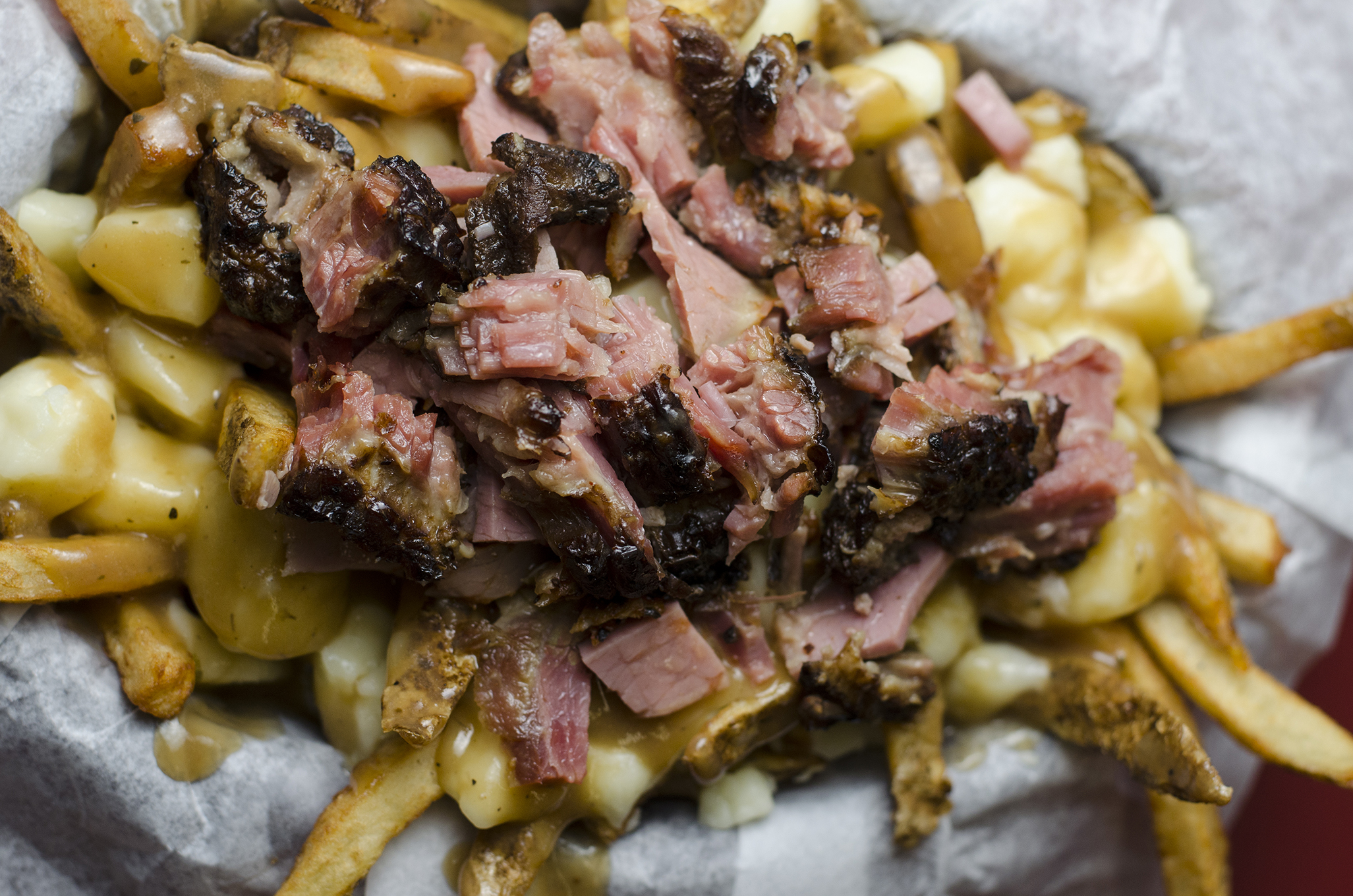 Two Canadian classics in one dish: a Montreal smoked meat poutine from Malic's Deli in Windsor, Ontario.