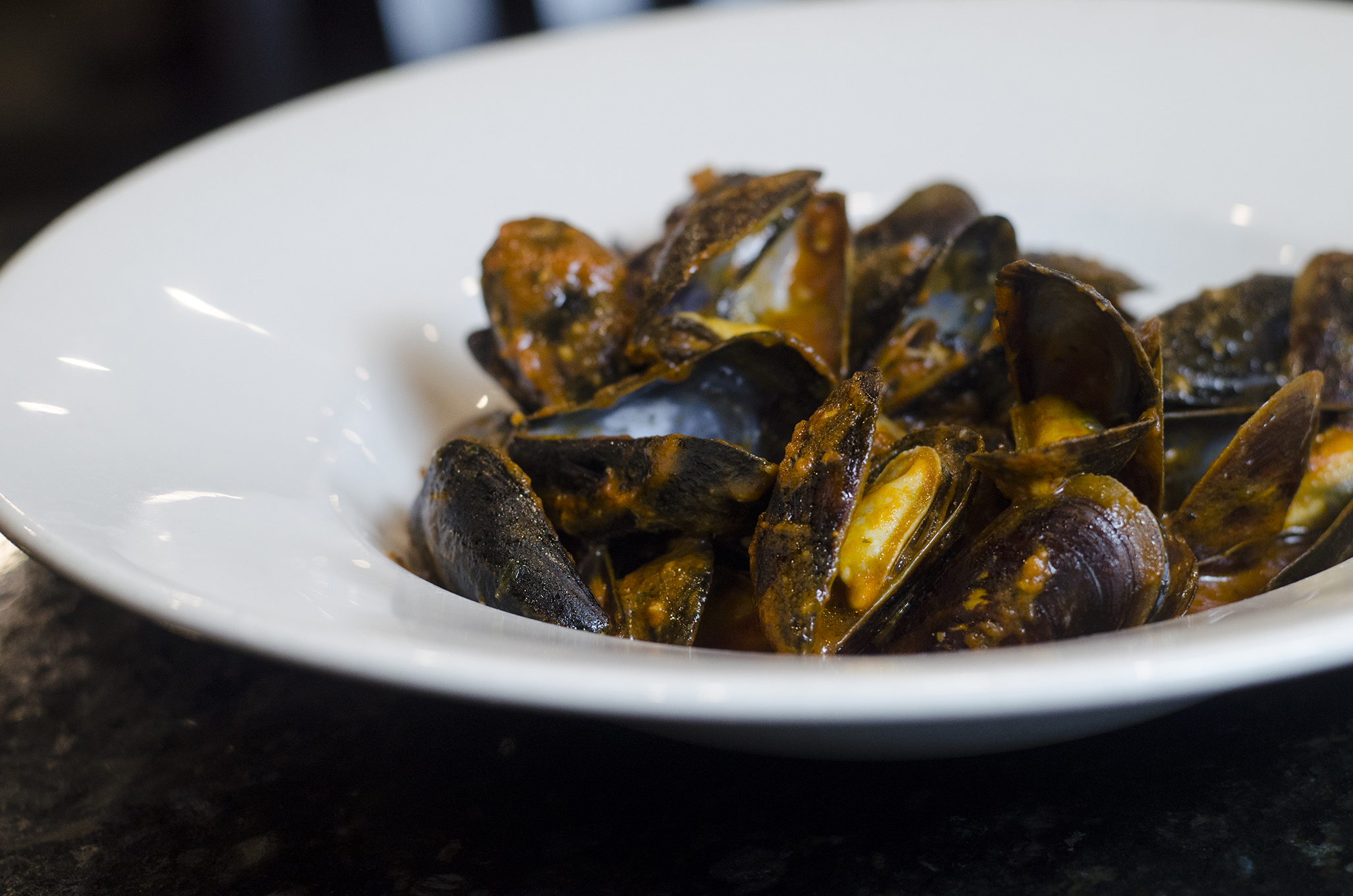 Fresh mussels sautéed in a white wine tomato sauce at Enzo's in Windsor, Ontario.