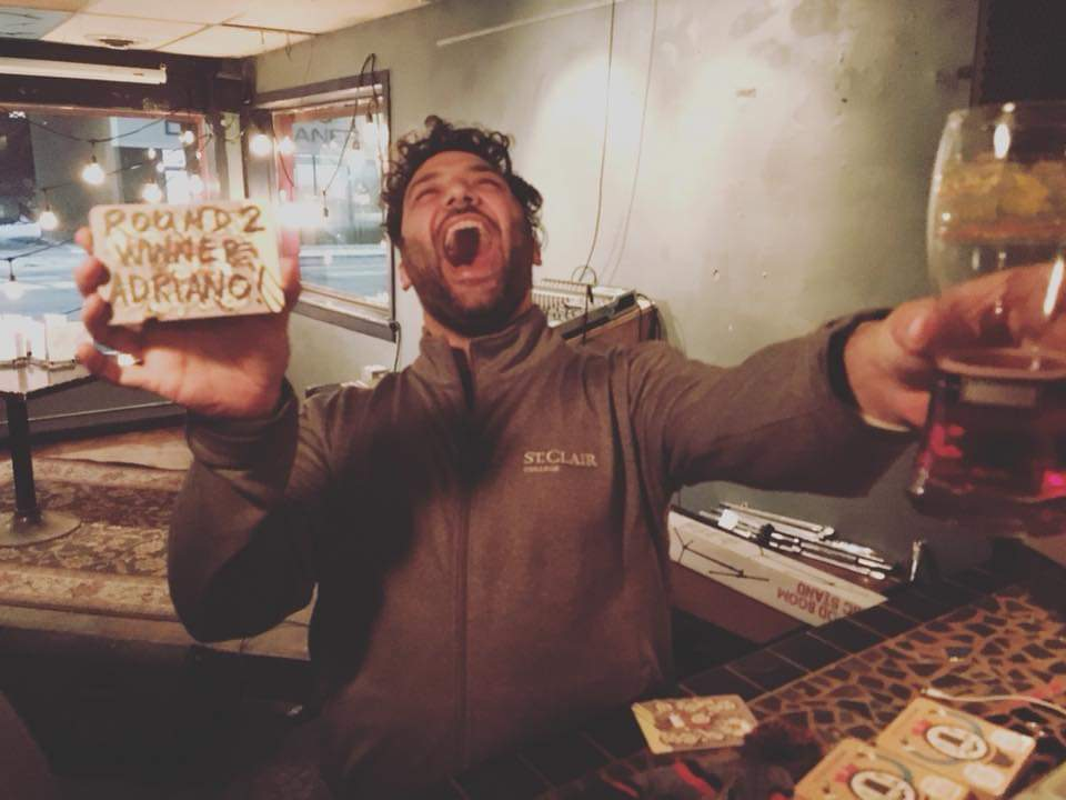 Adriano Ciotoli of WindsorEats celebrating a win at the Coaster Throwing Championships at Phog Lounge in Windsor, Ontario.