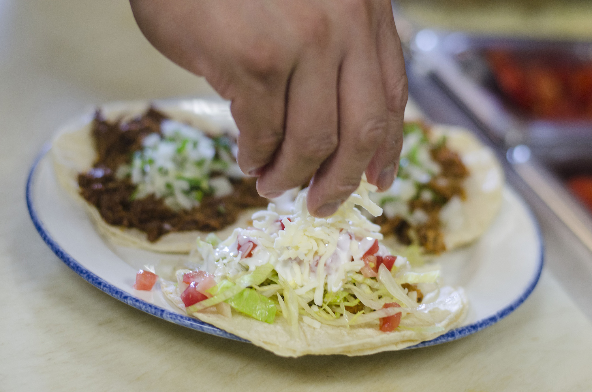 Putting the final touches on some tacos at Tacos Tony in Leamington, Ontario.