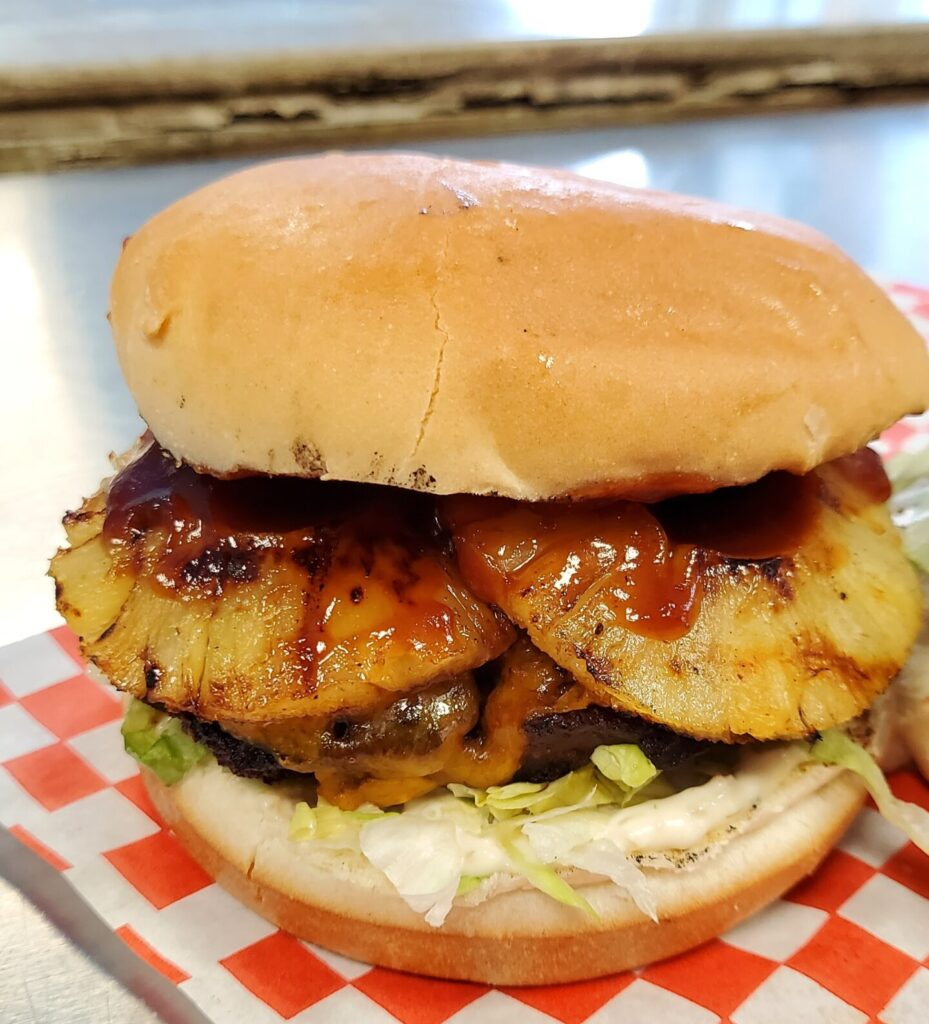 Grilled Pineapple Burger from Smokies BBQ at the Outdoor Food Hall in Windsor, Ontario.